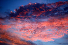 Wild Sky. Sunset skies in right red and blue, wild shapes and colors Stock Photo