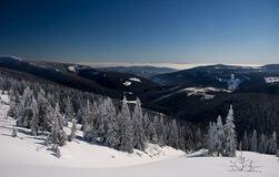 Wild snowy mountains view. Wild Giant mountains view during nice winter day with clear sky and inversion Stock Image