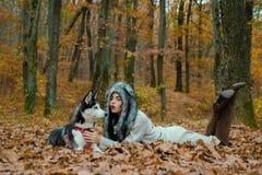 Wild in soul. Siberian husky favorite pet. Animal husbandry. Girl pretty stylish woman walking with husky dog autumn royalty free stock photography