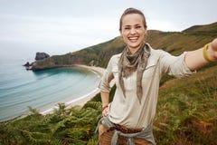 Woman hiker taking selfie in front of ocean view landscape Royalty Free Stock Image