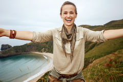 Woman hiker taking selfie in front of ocean view landscape Stock Photo