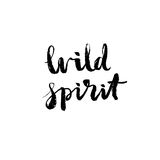 Wild spirit - hand drawn lettering vector. Wild spirit - hand drawn lettering design. Ink black brush painted phrase isolated on white background, photo overlay Royalty Free Stock Photos