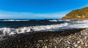Wild stone beach on coas panorama Stock Photo