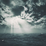 Wild storm on the sea. With sun beam from the cloudy skies Royalty Free Stock Photos