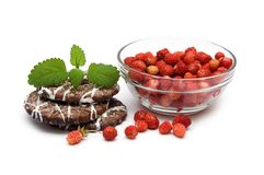 Wild strawberries and cookies Royalty Free Stock Image