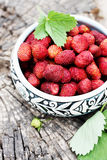 Wild strawberries in an old clay bowl, top view Royalty Free Stock Image