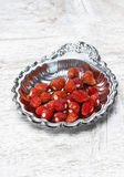 Wild strawberries on silver plate Stock Photography