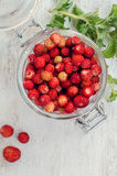 Wild strawberry in glass jar Stock Images