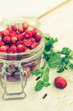 Wild strawberry in glass jar Royalty Free Stock Images