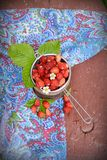 Wild strawberry in a wooden bowl Royalty Free Stock Photography