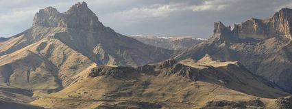 Wild summits. This is gloomy summits in Caucasus mountains in evening Royalty Free Stock Image