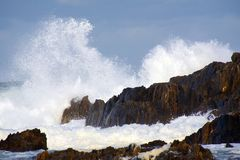 Wild Surf. Hitting rocks on the shore Royalty Free Stock Photo