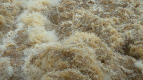 Wild swirling water released from irrigation dam, caught on high speed shutter. stock photo