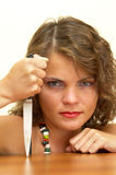 Wild thing. Young woman looking mean with a knife in the hand portrait royalty free stock photo