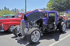 Wild three Window Coupe. This purple Ford three window coupe has been heavily customized and includes a pair of 'suicide' doors, popular with designers in the Royalty Free Stock Photos