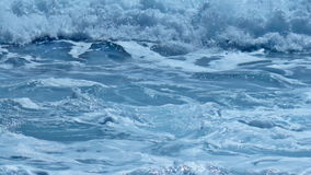 Wild to Calm Fresh Foam Splash Turquoise Sea Water Waves. Static medium long close up shallow depth of field shot of white foamy waves rolling and splashing over stock footage