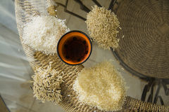 Wild types of rice on table. Different types of asian rice, chopsticks, straw matt for rolls, soy sauce Royalty Free Stock Photos