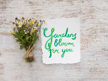 Wild viola flowers bouquet and watercolor lettering Stock Photography