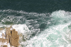 Wild water. Strong waves hitting a rock Stock Photo