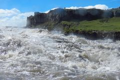 Wild river water splashing, even on camera lens, at Dettifoss waterfall, Iceland. Close view of wild water from the Jokulsa a Fjollum river splashing on camera royalty free stock photos