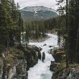 Wild waterfall and forests all around