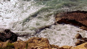 Wild waters strong waves at the cliffs stock footage