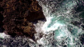 Wild waters strong waves at the cliffs stock video footage