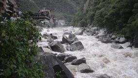 Urubamba River stream. Wild waters of Urubamba river in Peru after heavy tropical rains, panoramic footage stock video