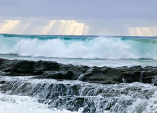 Wild waves, stormy weather and rocks, Australian c Stock Images