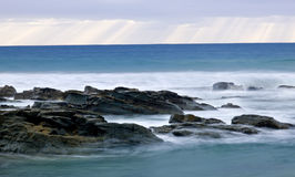 Wild waves, stormy weather and rocks, Australian c Royalty Free Stock Photos