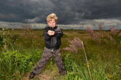 Young Boy standing on waste land Royalty Free Stock Images