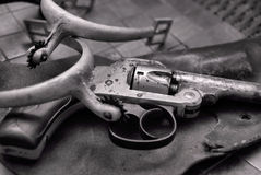 Wild West. Old gun, holster, and spurs from times past, in black and white stock images