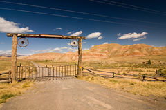 Wild west. A gate and a fence in desert, wild west Royalty Free Stock Photo