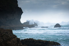 Wild West Coastline. MS: The west coast beaches near Auckland, New Zealand, are notorious for wild windswept surf. Here the spray and mist cover the infamous stock photos