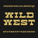 Wild West font. Vintage alphabet. Wooden letters and numbers. Stock Images