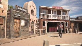 Wild West frontier style facade in Tombstone, Arizona, with cowboy actor