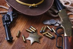 Wild west gun, ammunition and U.S. Marshal Badge. On wooden table action arms cowboy firearms power shot shotguns weapons western repeating lever-action war stock images