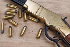Wild west gun with rounds royalty free stock photography