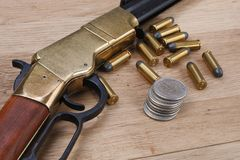 Wild west gun with rounds stock photography