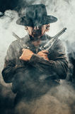 Wild West Gunslinger. Frantic looking wild west gunslinger Royalty Free Stock Photo
