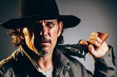 Wild West Gunslinger. Frantic looking wild west gunslinger Stock Image