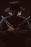Wild West Gunslinger. Frantic looking wild west gunslinger Stock Images