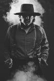 Wild West Gunslinger. Frantic looking wild west gunslinger Royalty Free Stock Photos