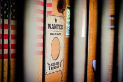 Wild West jail and wanted sign with american flag in the backgro Stock Photos