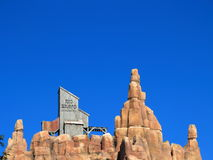 Wild west mountain top setting at rich blue sky Royalty Free Stock Photo
