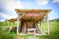Wild west movie set ,North of Fuzine , Croatia. Fuzine , Croatia - June 4. 2017. undertaker house in abandonet wild west movie set stock photo