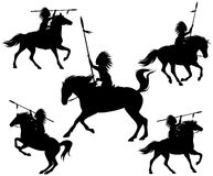 Wild west silhouettes. Native american warriors riding horses Royalty Free Stock Photo