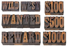 Wild west, wanted and reward. Wild west, wanted, reward - western memorabilia concept - isolated text in vintage letterpress wood type - French Clarendon font Stock Photo