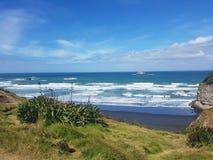 Wild wild west coast. Remote Rough west coast black sand surf beach Stock Photography