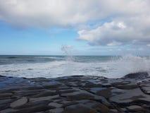 Wild wild west white wash waves. Waves crashing on rocks Stock Photo